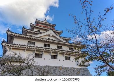 The side angle of Karatsu japanese Castle (Karatsu-jo) Located on hill with blue sky and clouds, Karatsu, Saga, Kyushu, Japan