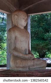 Side angled view of Granite Samadhi Buddha Statue in the posture of Dhyana Mudra, Mahamewna Park, Anuradhapura, Sri Lanka