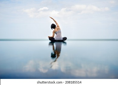 side bend, side stretching with swimming pool view