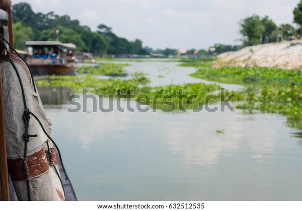 Side boat while cruising the river in Uthaithani province.
