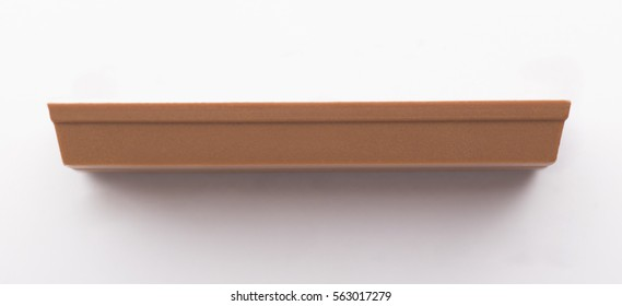 Side of the chocolate bar isolated on white background
