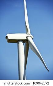 Side Closeup of Wind Turbine. Alternative Energy Theme. Vertical Photography