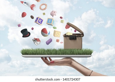 Side close-up of woman's hand holding digital tablet with green grass and trash can on screen and with misc objects falling from sky on to grass. Excessive waste. Trash crisis. Consumerist attitude.