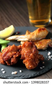side dishes (karaage,grilled chicken wings,edamame) and beer
