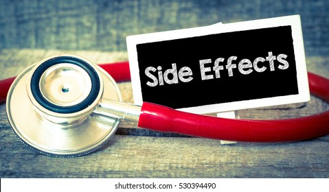 Side effects inscription by stethoscope /Blackboard with word side effects and stethoscope. Medicine concept