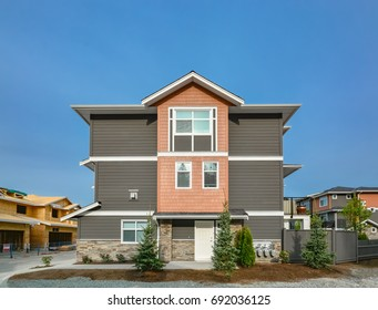 Side entrance door of brand new residential triplex townhouse. Family house for sale