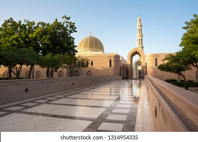 Side entrance to the Great Mosque of the Sultan Qaboos with reflections on the marble
