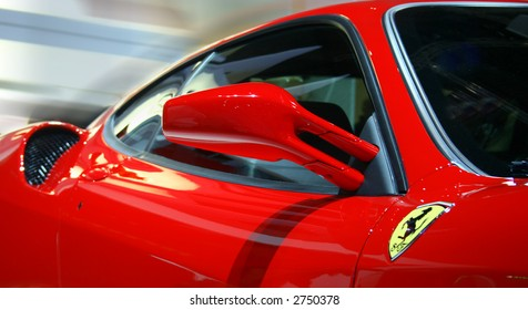 Side of a Famous Sports Car. Focus on Side Mirror.