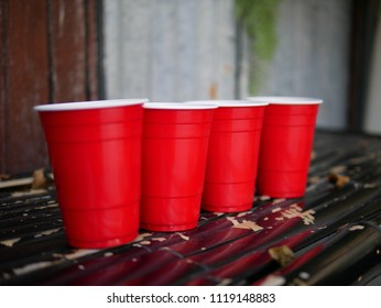 Side of four red cups