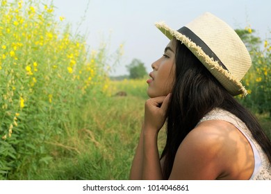 Side look of attractive woman with nature background.