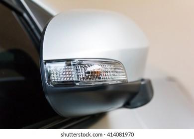 Side mirror light of grey car.