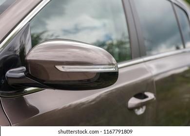 Side mirror of modern car, closeup