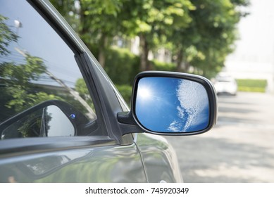 Side mirror Reflecting on the sky