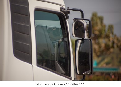 Side mirrors, cabs, trucks that were seen on the side