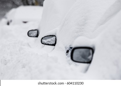 """Side mirrors from cars stick out from the snow as the cars were buried by the snowstorm """"Stella"""" in Montreal."""