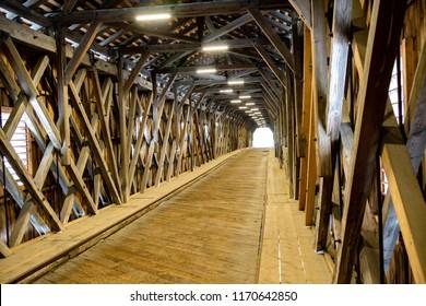 In side the old wooden bridge on the border between Liechtenstein and Swizterland