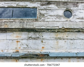 Side of a old worn fishing trawler