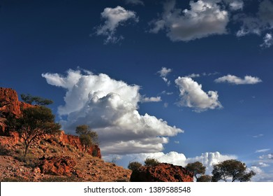 Side on view of Cumulonimbus clouds forming the start of a thunderstorm. Low foreground and to the left, making the sky and clouds the main part of the composition.