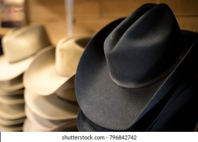 a1adb275 Side perspective close up on a stack of traditional black felt cowboy hats,  with wide