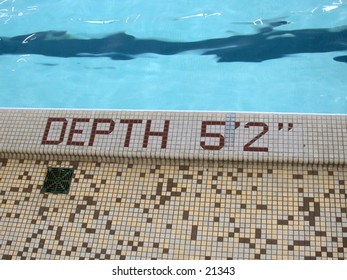 Side of pool, with depth marker inset with tiles to state Depth 5 foot 2 inches