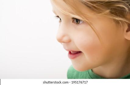 Side portrait of beautiful little girl