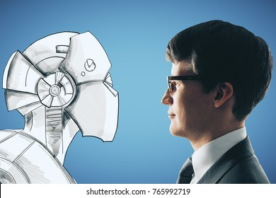 Side portrait of handsome young businessman facing drawn robot on blue background. Creativity and robotics concept