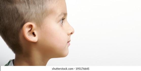 Side portrait of little boy