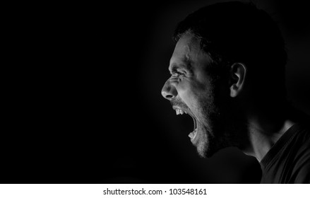 Side portrait of a shouting man