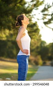 Side portrait of a smiling woman resting after exercise workout