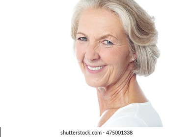 Side pose of senior woman against white background.
