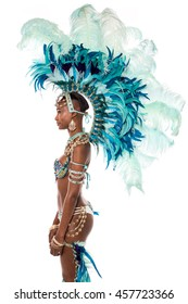 Side pose of woman samba dancer wearing pretty head wear.