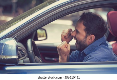 Side profile angry driver with fists up screaming. Negative human emotions face expression