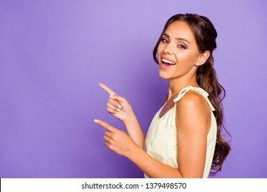 Side profile close up photo portrait of attractive charming nice glad optimistic lovely dreamy she her lady indexing indicating yo the empty place isolated violet background