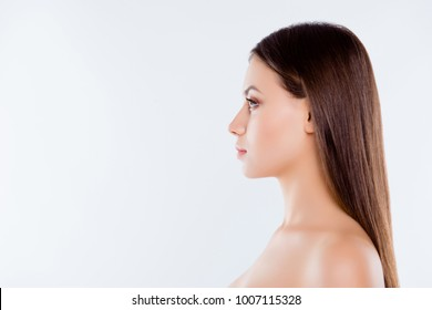 Side profile close up view portrait of pretty beautiful brown-haired brunette woman with pure flawless ideal sensual sensitive smooth skin straight nose and hair isolated on white background copyspace