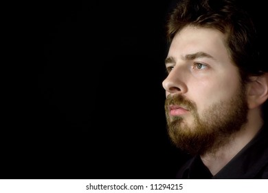 Side Profile Face of Bearded Serious Man