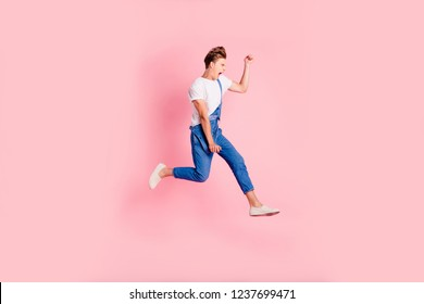 Side profile full length body size studio photo portrait of man running teenager student going away gesturing with hands isolated on pastel background