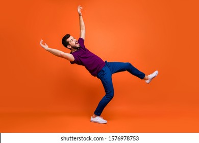 Side profile full length body size of confused man falling down being blown by gust of wind in white foot wear isolated screaming over vivid color background