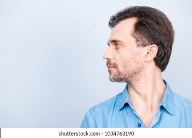 Side profile half-faced view photo of minded pensive thoughtful pondering planning handsome brunette hairstyle wearing jeans denim isolated on gray background copy-space looking aside