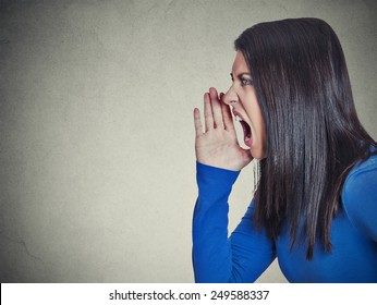 Side profile headshot beautiful angry woman screaming