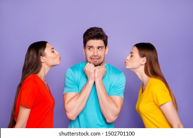 Side profile photo of two beautiful colorful ladies want to kiss one feared troubled worried handsome grimacing macho isolated violet background