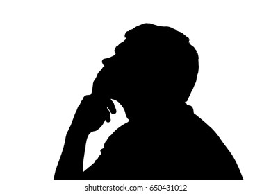 Side profile portrait silhouette of a teenage boy thinking finger on lips