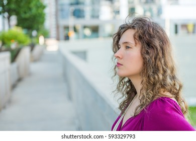 Side profile portrait of woman in urban city in Chicago