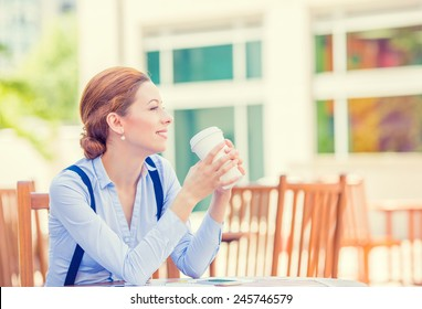Side profile portrait young smiling woman drinking coffee outside corporate office isolated city building background coffee shop. Positive human face expression, emotion, life success, leisure concept