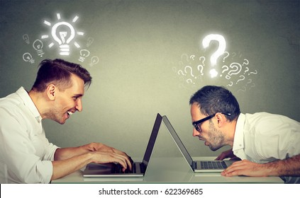 Side profile two men using laptop computer one educated has bright ideas the other ignorant has many questions. Level of technology education concept