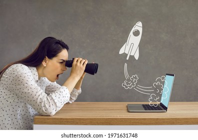 Side profile view astonished lady looking in binoculars at rocket flying out laptop computer screen. Surprised girl watching accelerated growth of modern digital startup of successful business rival