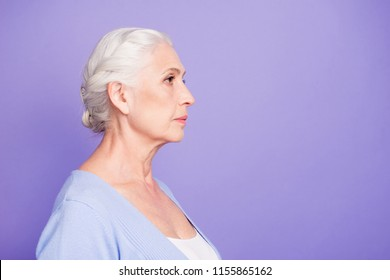 Side profile view portrait of beautiful nice content serious gray-haired old lady wearing casual. Isolated over pastel violet purple background