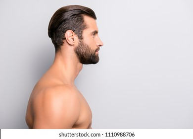 Side profile view portrait of confident attractive sexy naked nude modern trendy stylish sportive strong muscular bearded man looking aside isolated on gray background copyspace