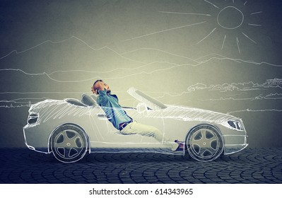 Side profile young business man relaxes in his driverless car