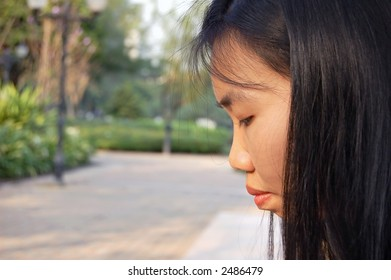 Side profile of a young Thai woman