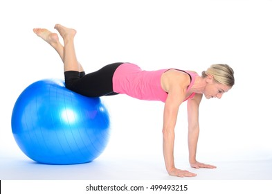 Side rear view on woman performing abdominal strengthening exercises with legs raised and arms reaching forward